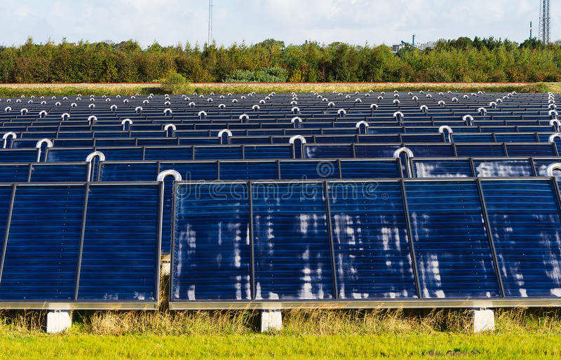 Solar heating plant. Producing hot water for power and house heating royalty free stock photography