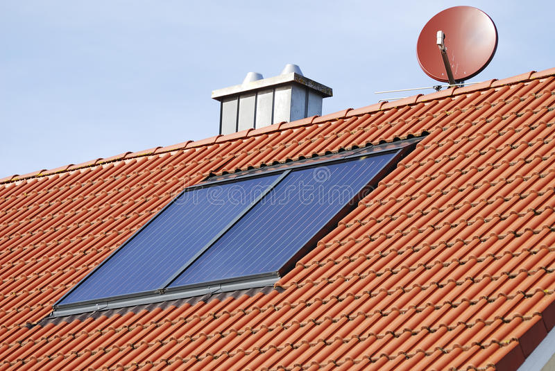 Solar heating system. On the roof of a house stock images