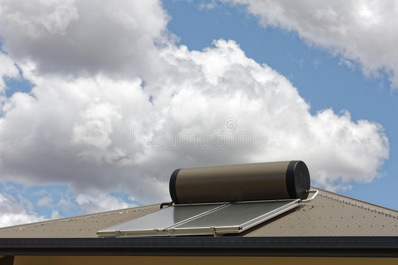 Solar hot water panels. Solar panels on roof to heat water from the sun stock image
