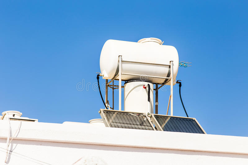 Solar Hot Water System. Solar heater for green energy. Contemporary hot water panels on a house stock photo