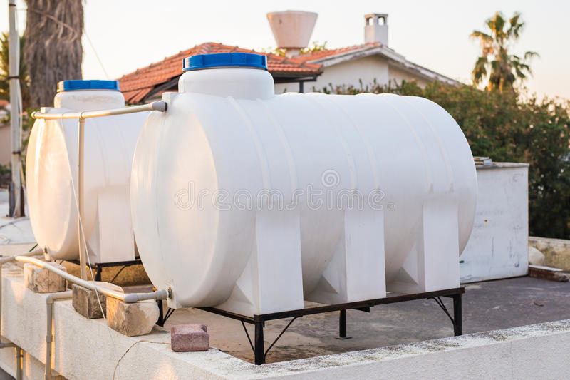 Solar Hot Water System. Solar heater for green energy. Contemporary hot water panels on a house stock photography