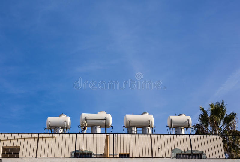 Solar Hot Water System. Solar heater for green energy. Contemporary hot water panels on a house royalty free stock photo