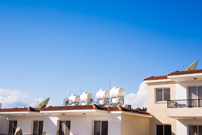 Solar Hot Water System. Solar heater for green energy. Contemporary hot water panels on a house stock image
