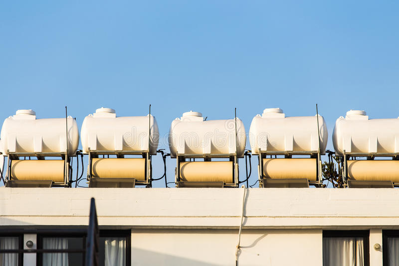 Solar Hot Water System. Solar water heating system on the rooftops royalty free stock photography