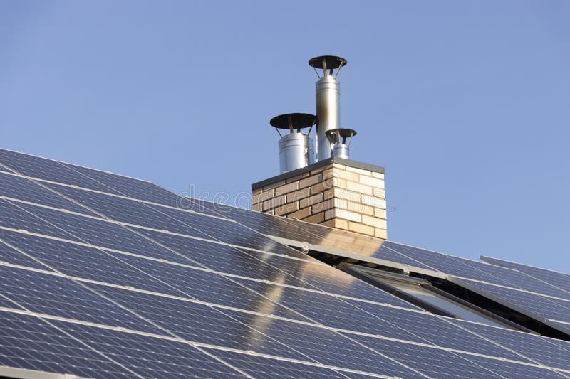 Solar installation for generating green electricity on the roof of a residential house. Solar installation the generation of green electricity and water heating stock images