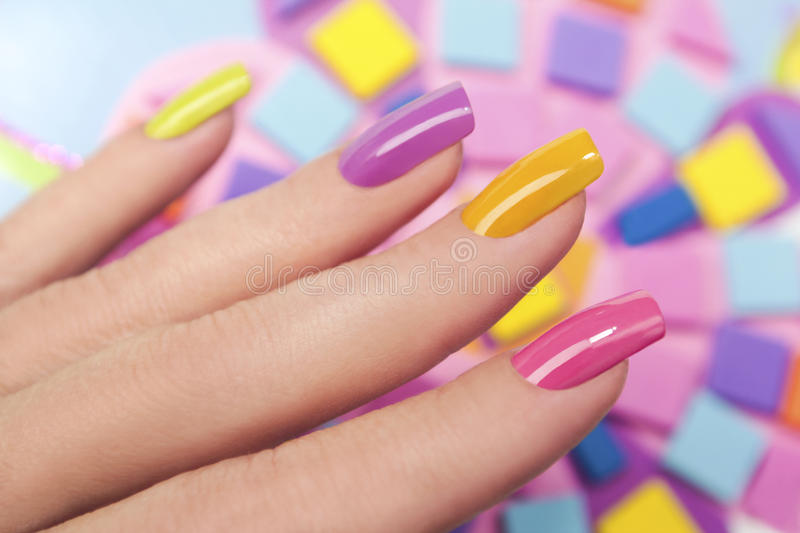 Solar nails. Solar nails are covered with multicolored with colored lacquer on the female hand