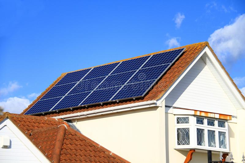 Solar panel on roof top no people stock photo. Solar panel on top of a roof with blue sky in the background on a sunny day no people stock photo royalty free stock image