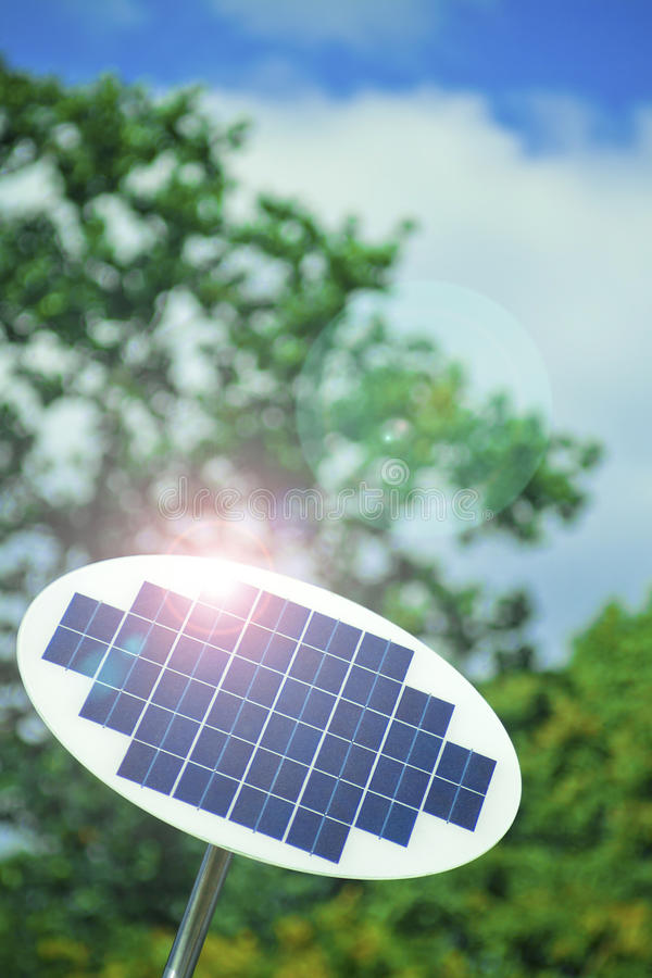 Solar panel. A photovoltaic Solar Panel with tree in the background royalty free stock images