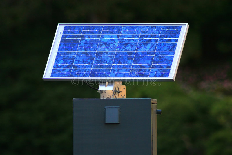 Solar Panel. Mounted and operational solar panel used to transmit water level height at a dam stock photos