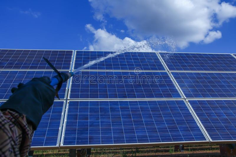 Solar panel, alternative electricity source - concept of sustainable resources, This`s the sun tracking systems, Cleaning will. Increase performance to high stock image