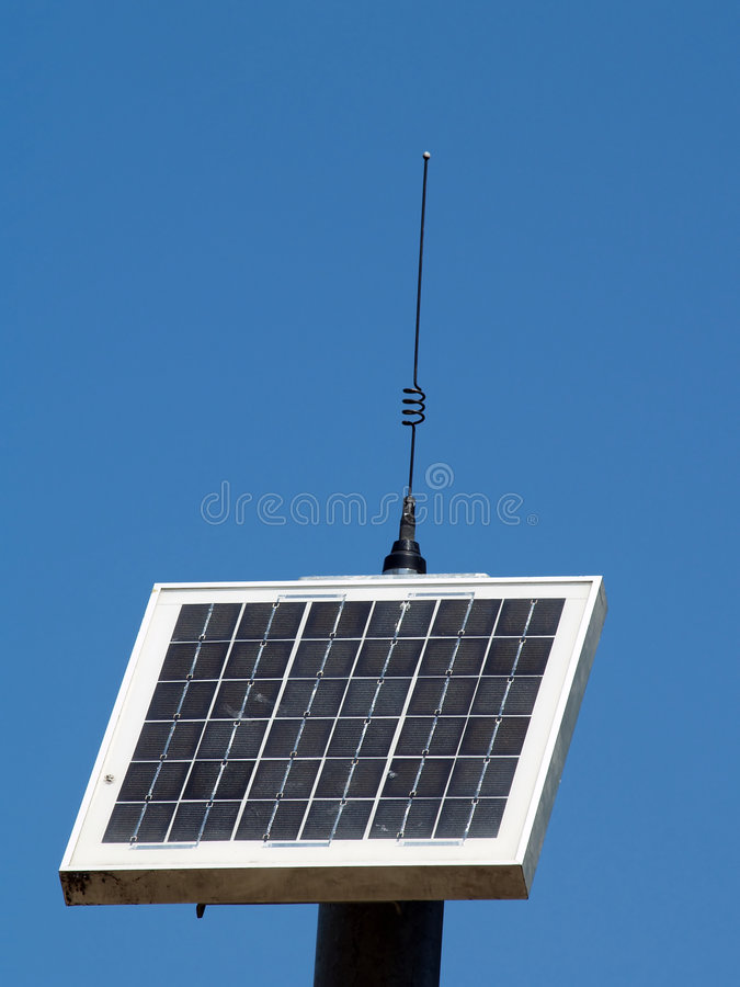Solar Panel With Antennae Against Blue Sky Stock Images