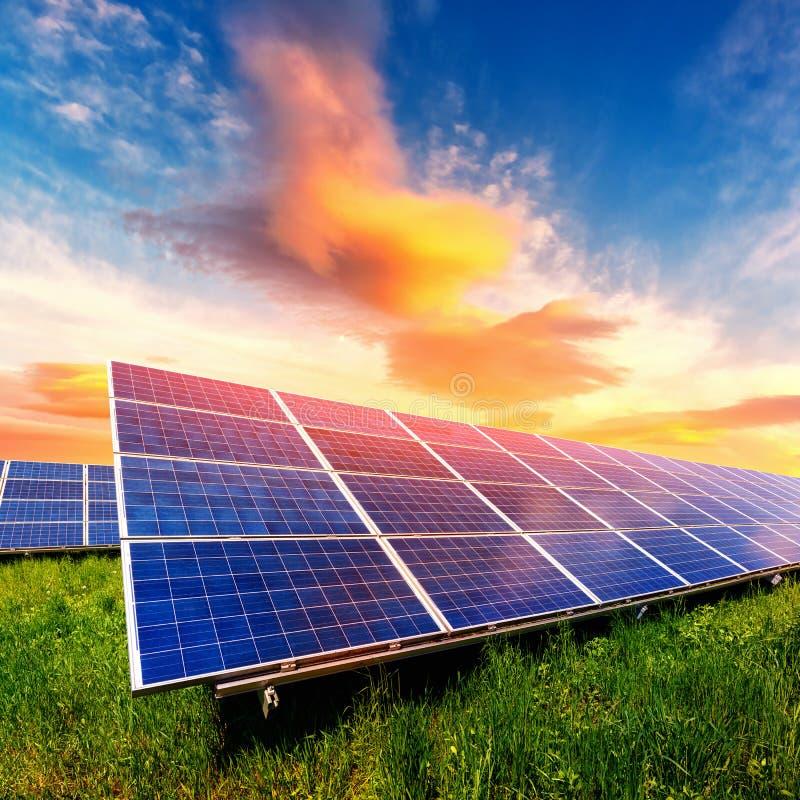 Solar panel on beautiful orange sundown background stock photos