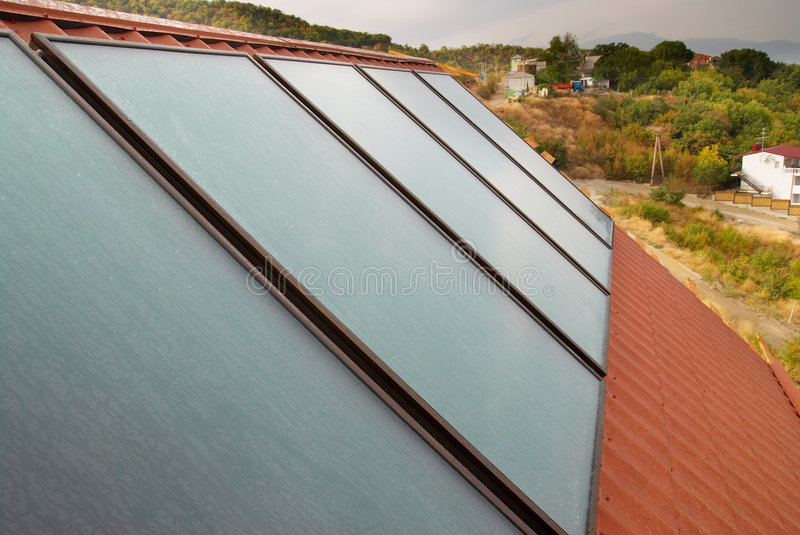 Solar panel (geliosystem). Solar panel (geliosystem) on the house roof royalty free stock photography