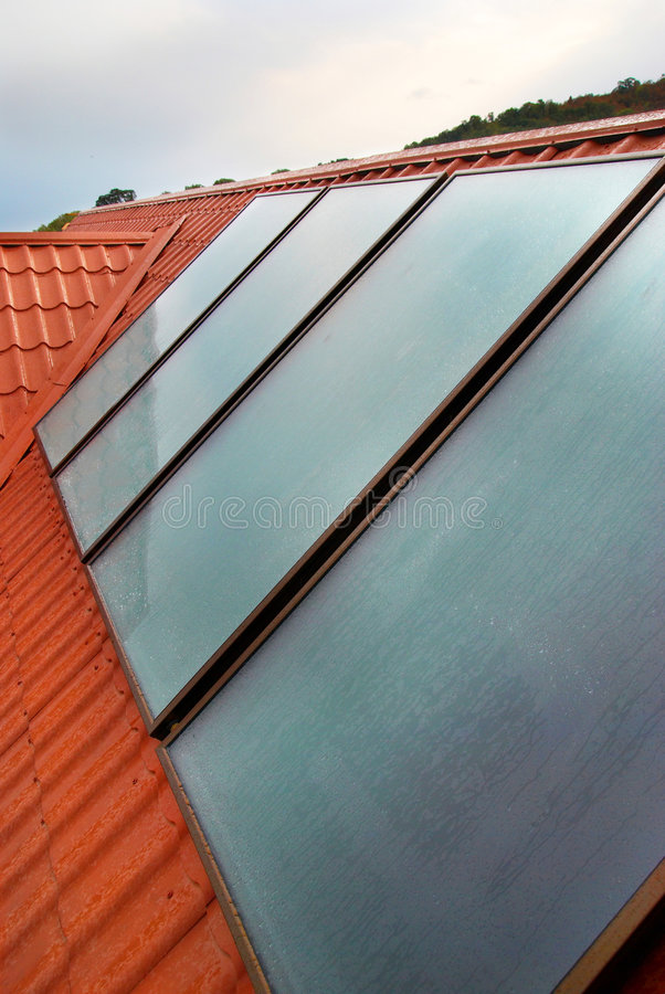 Solar panel (geliosystem). On the house roof stock photography