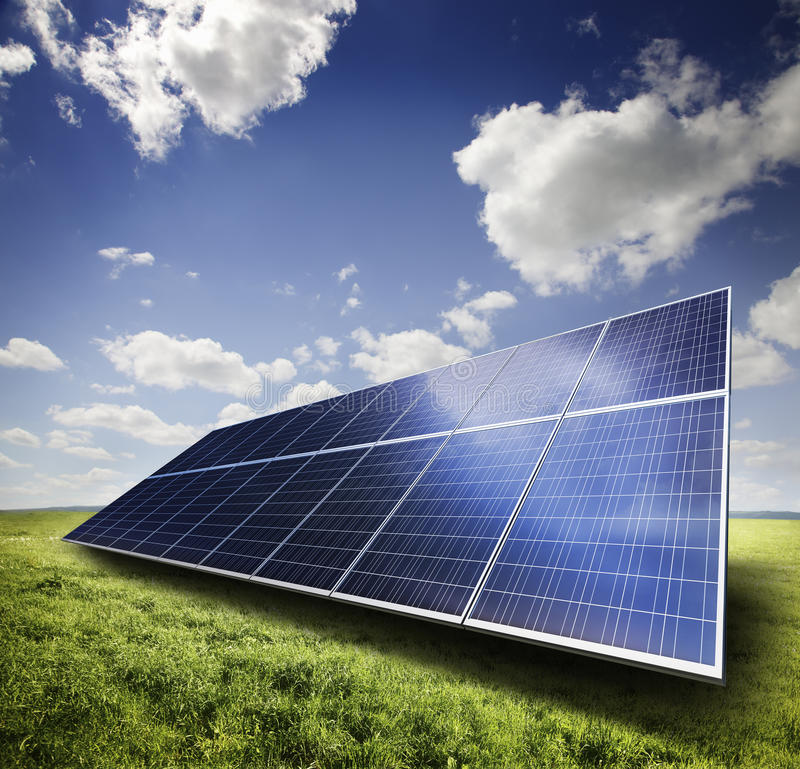 Solar panel. In a green field royalty free stock photos