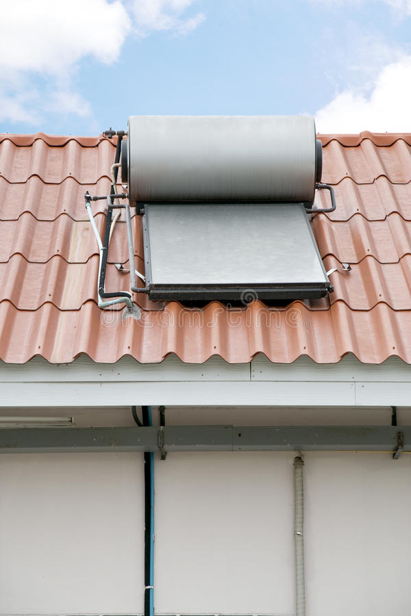 Solar panel of hot water installed on rooftop royalty free stock photos