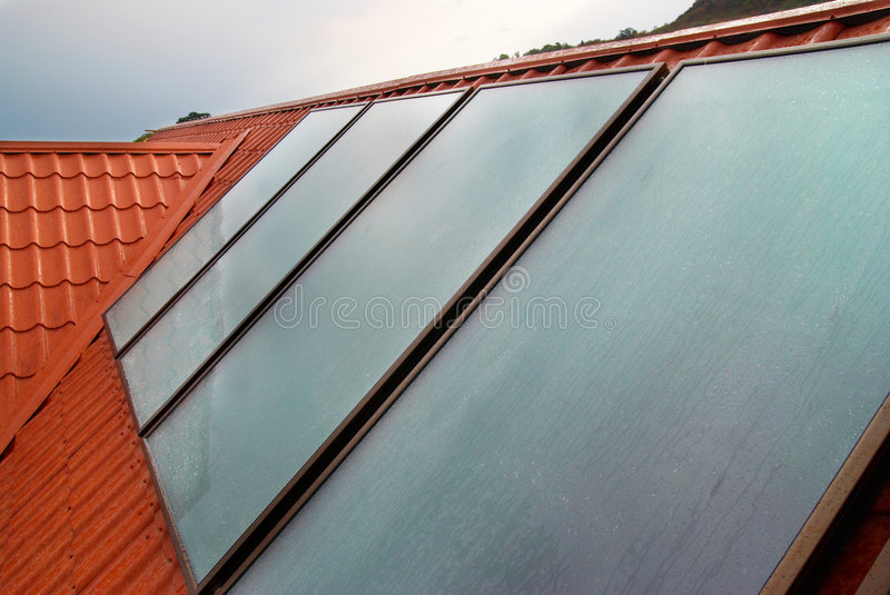 Solar panel on the house roof. Solar panel (geliosystem) on the house roof royalty free stock photos