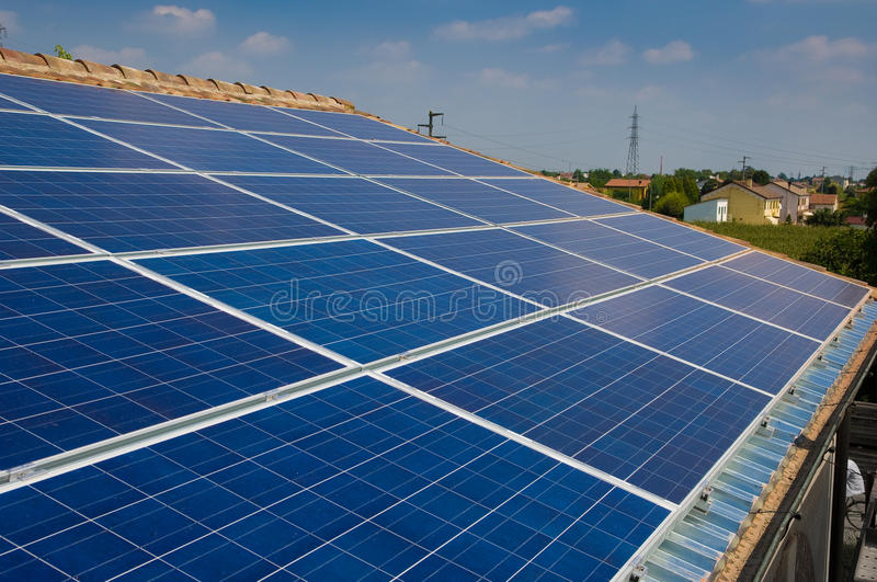 Solar panel on a house roof. Green energy from sun.  royalty free stock image