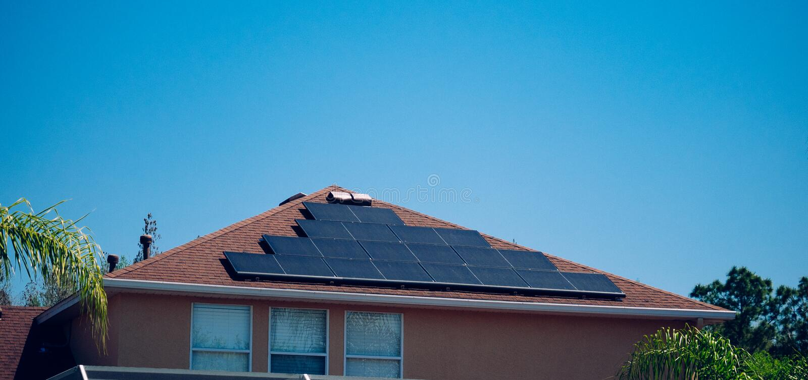 Solar panel on a house roof. Green energy from sun royalty free stock photography