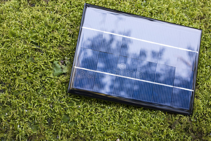 Download Solar panel on the moss stock image. Image of science - 34384175