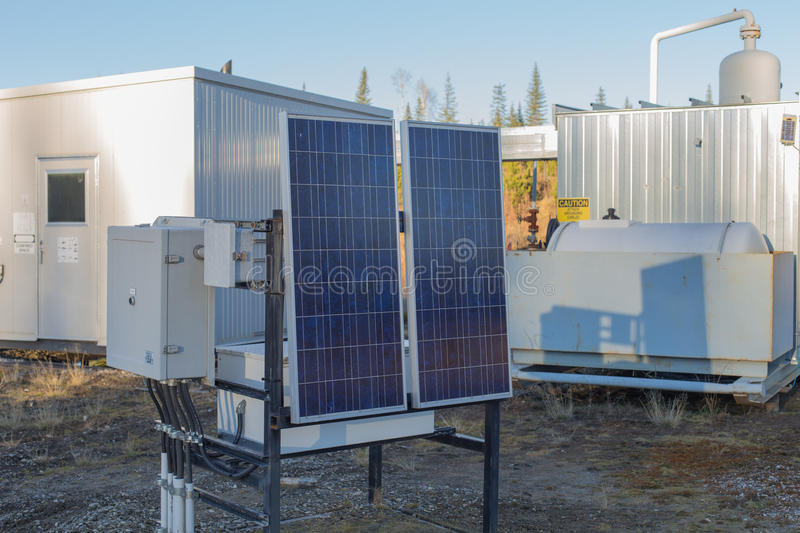 Solar panel at natural gas site. Solar panels at a natural gas wellhead site royalty free stock images