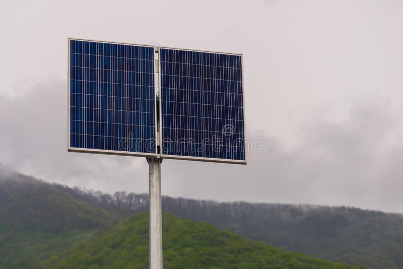 Solar panel, photovoltaic, alternative electricity source - concept of sustainable resources. Energy, blue, clean, environment, power, renewable, technology royalty free stock image