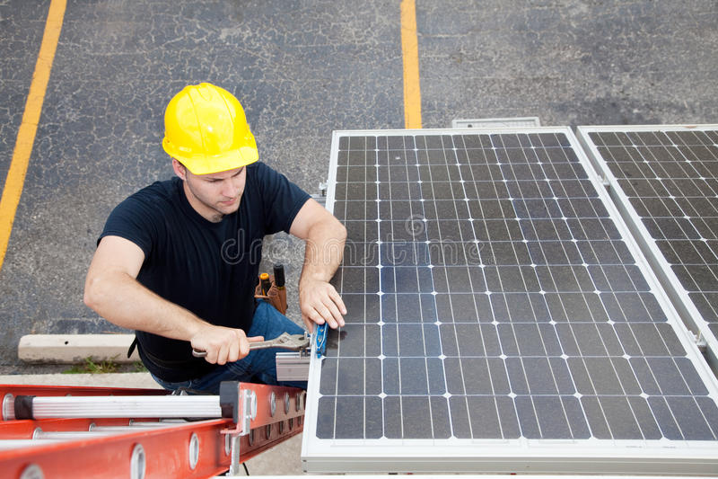 Solar Panel Repair with Copyspace stock photo