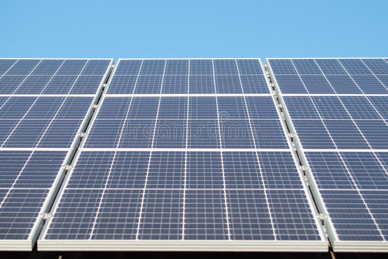 Solar panel on roof close up. Alternative electricity source - ecological power generation stock photography