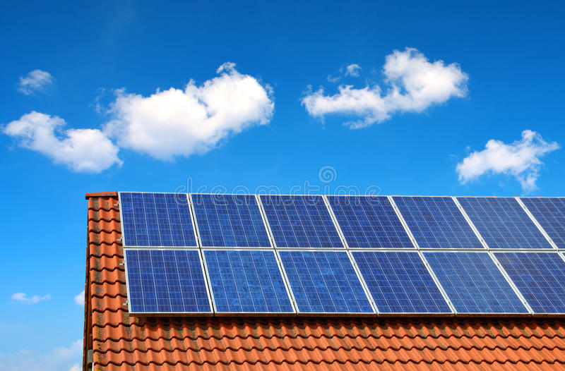 Solar panel on the roof of the house. Solar panel on the roof of the house in the background blue sky stock photo