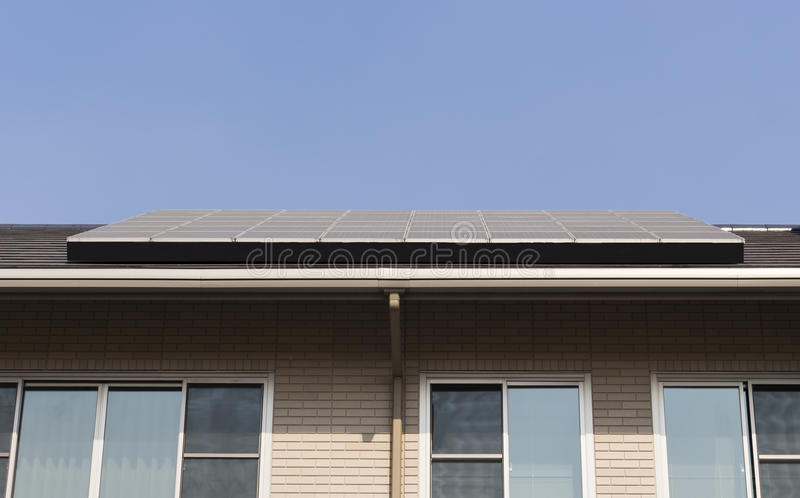 Solar panel on a roof house stock photography