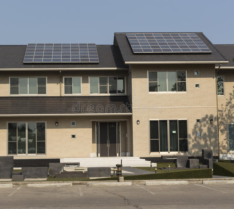 Solar panel on a roof house. Solar panel installation on a roof house on blue sky royalty free stock photos
