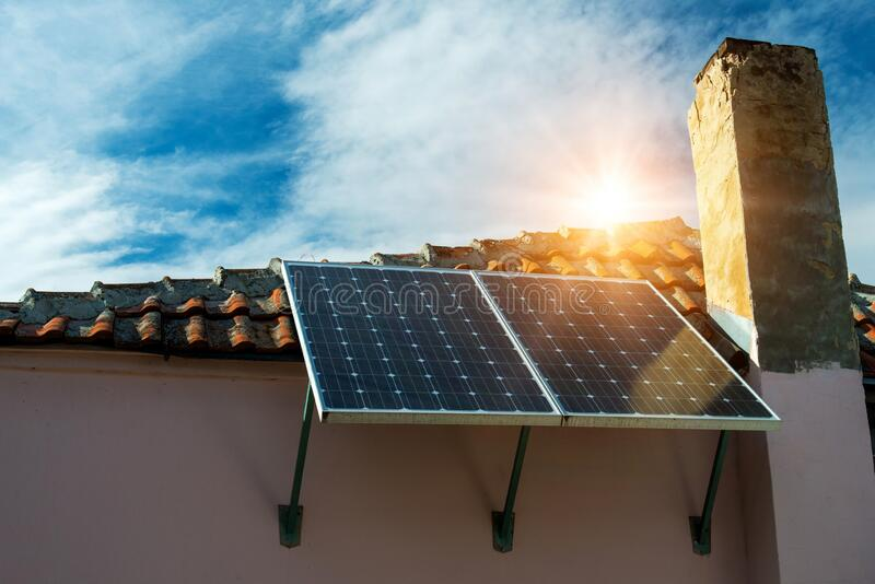 Solar panel on the roof of an old farmhouse -  concept of sustainable resources stock photo