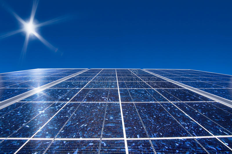 Solar panel and sun stock image