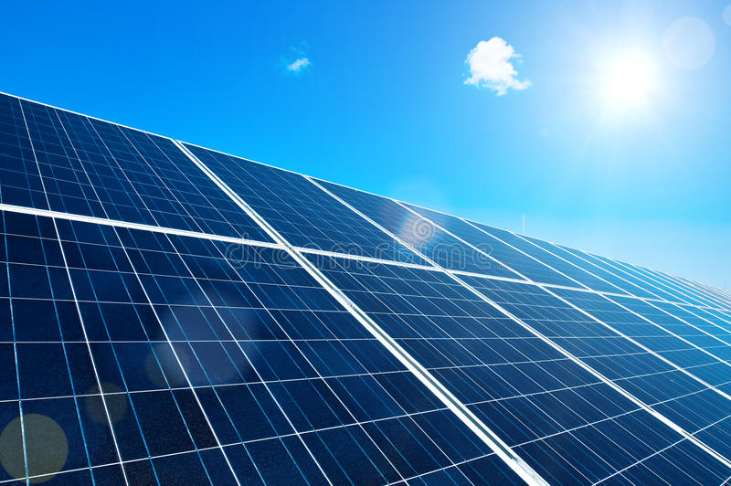 Solar Panel with Sun. And Lens Flares and blue Sky stock image