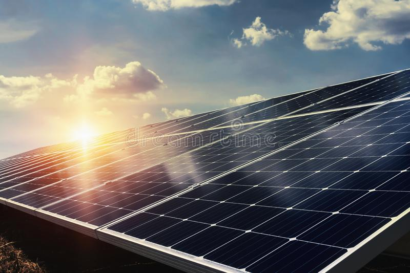 solar panel with sunlight and blue sky background. concept clean stock photography