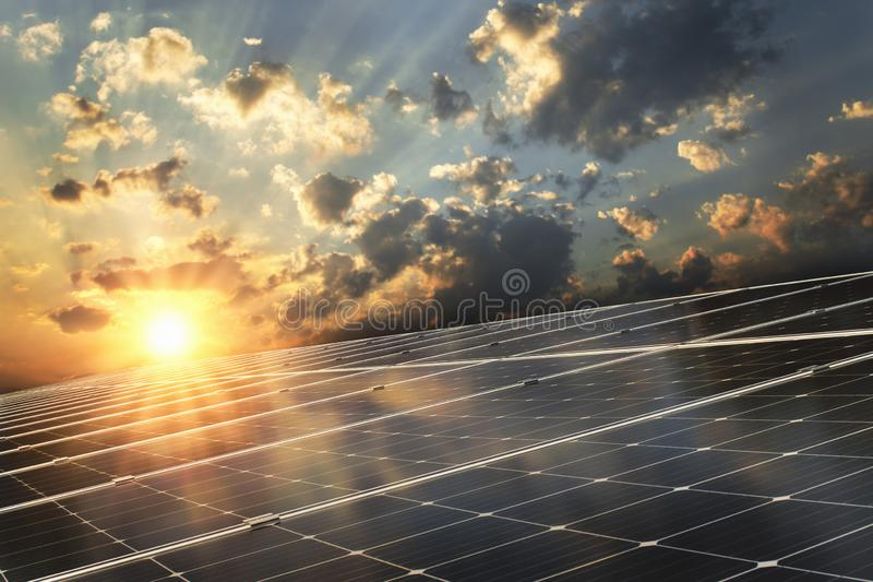 solar panel with sunset background. concept clean power stock images