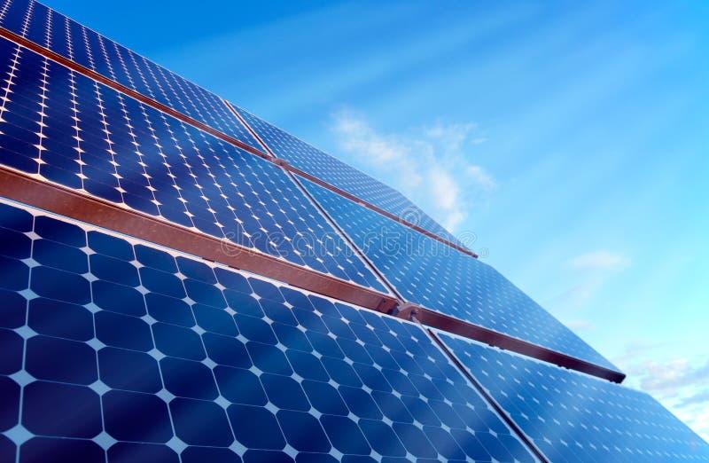 Solar Panel with sunshine. Sun is shining onto a solar panel stock photo