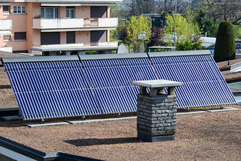 Solar panel system on house roof of Lugano stock image