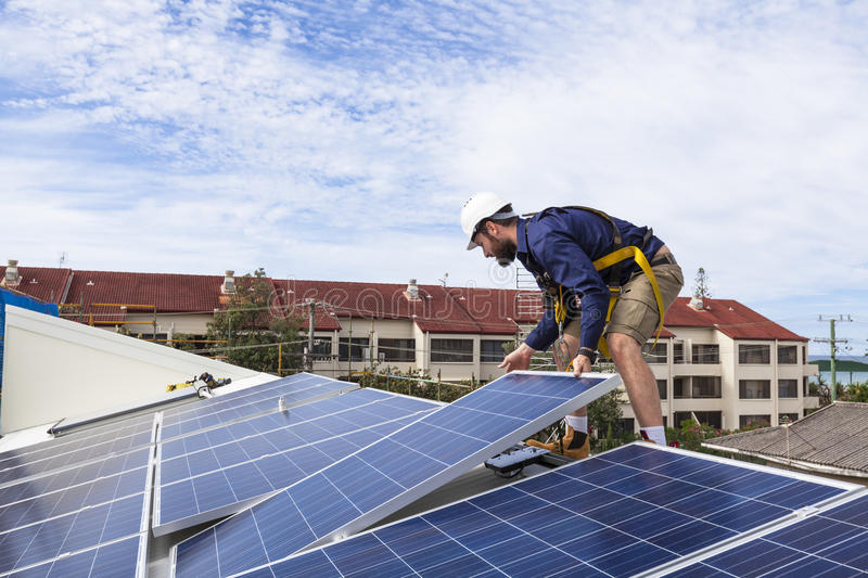 Solar panel technician stock photography
