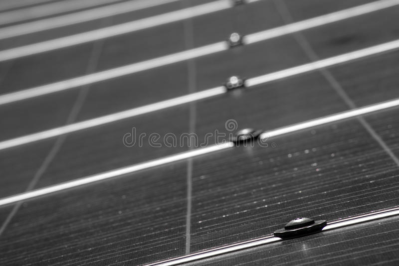 Solar Panel up Close. A low angle view in black and white of a solar pannel as it stretches away from the camera in to the distance royalty free stock photography