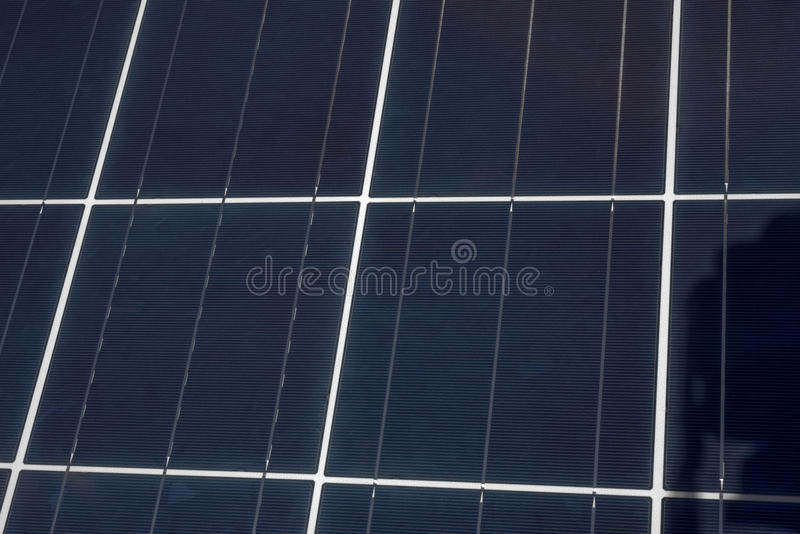 Solar Panel Up Close. An upclose view of the grids and square shapes of a solar panel stock photography