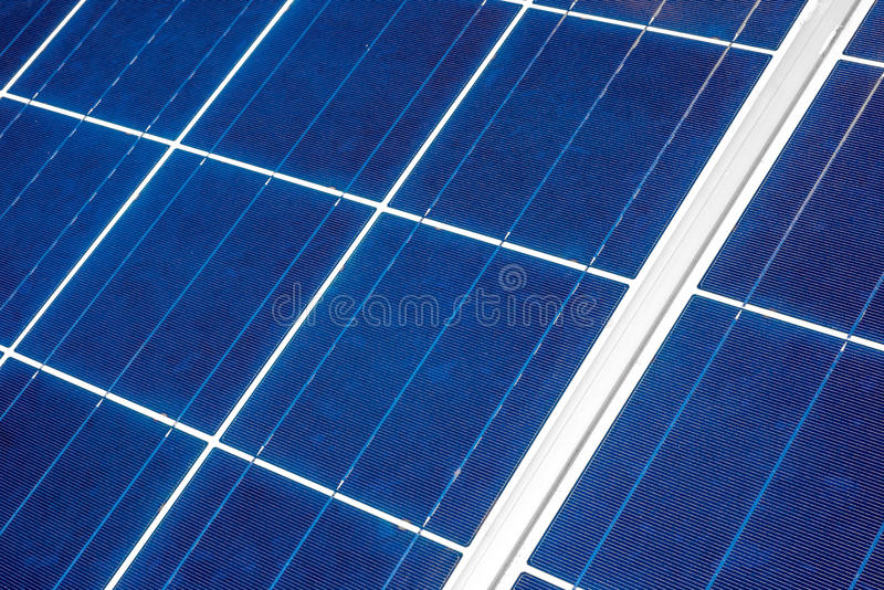 Solar Panel up Close. An up close view of a solar panel revealing the squares within which the individual solar strips are positioned as seen from a diagonal royalty free stock images