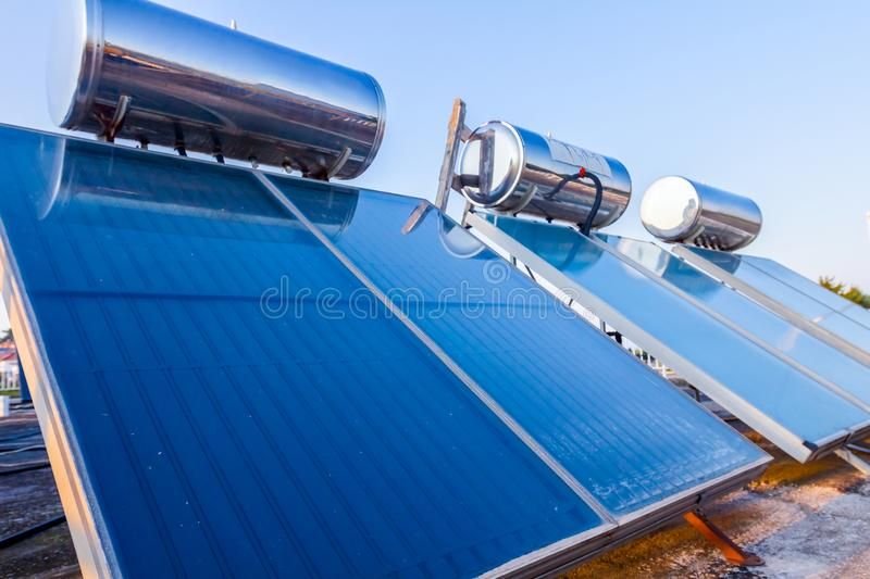 Solar panel, water heater on house roof, green energy stock images