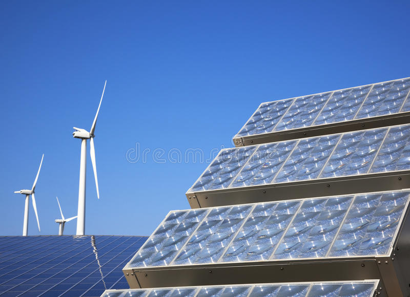 Solar panel and wind turbie royalty free stock photos
