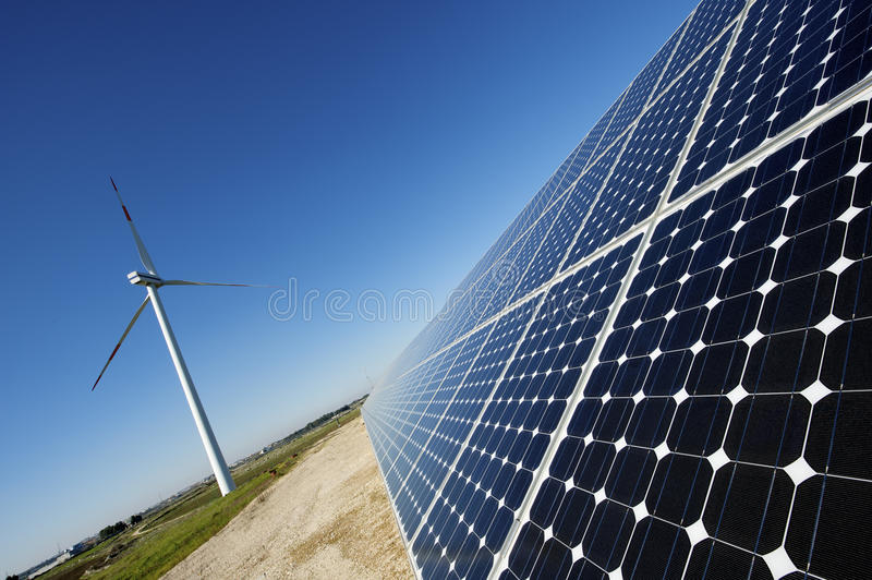 Solar panel and wind turbine royalty free stock image