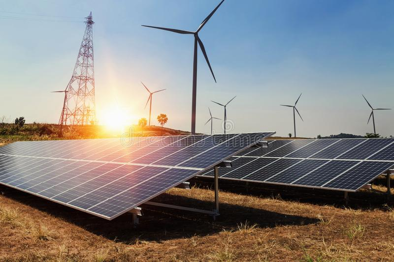 Solar panel with wind turbine and sunlight. clean power energy c. Oncept royalty free stock photo
