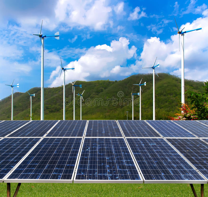 Solar panel and wind turbines stock photography