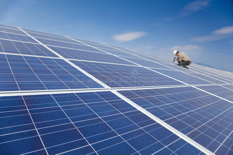 Solar panel and worker installing royalty free stock photos