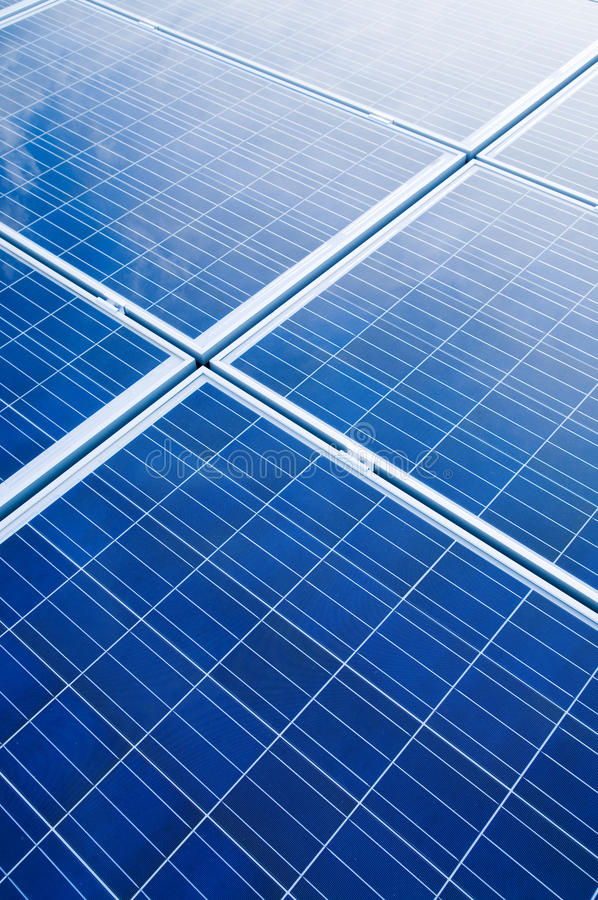 Solar panels. Blue solar panels pattern for sustainable energy stock photography