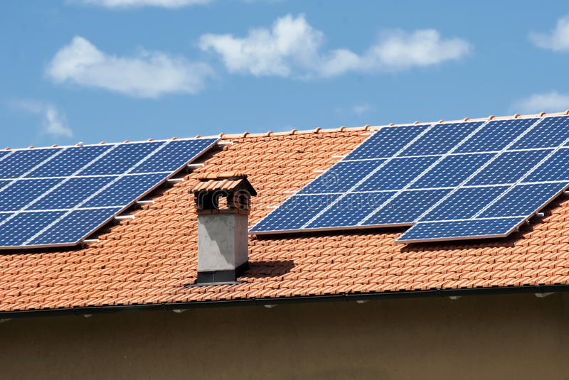 Solar panels. House roof with heat and power solar panels royalty free stock photography